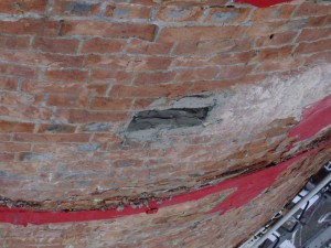 Loose & Deteriorated Areas of Brickwork & Resin Coating